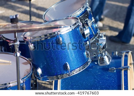 Set of blue drums isolated with clipping path. - stock photo