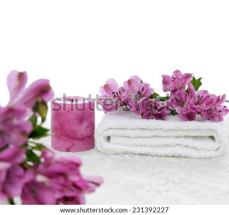 Set of branch orchid with candle and towel on the white lace background - stock photo