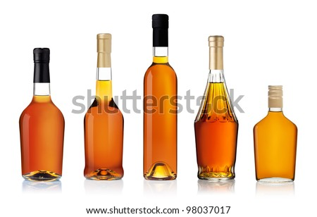 Set of brandy bottles isolated on white background - stock photo