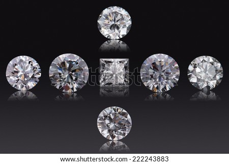 Set of brilliant luxury diamonds with different cut on black background - stock photo