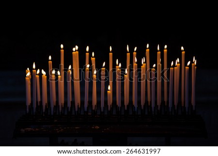 Set of burning candles in the church, italy - stock photo