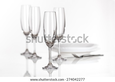 set of champagne glasses and plates - stock photo
