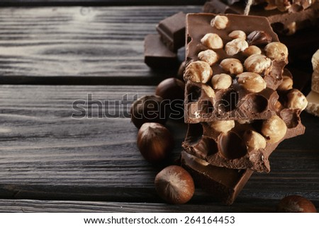Set of chocolate with hazelnut on wooden background - stock photo
