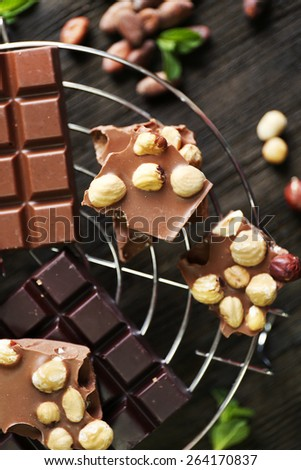 Set of chocolate with nuts on metal stand, top view - stock photo