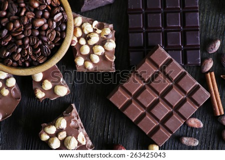 Set of chocolate with nuts on wooden table, top view - stock photo