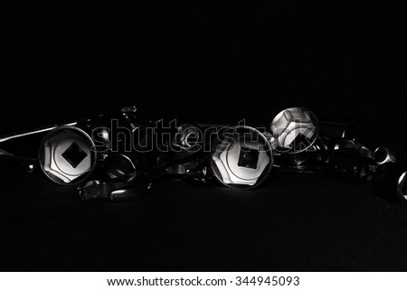 Set of chrome wrenches on black background. Close up. - stock photo