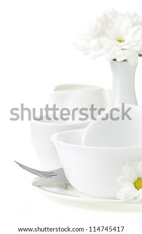 set of clean dishes isolated on white background - stock photo