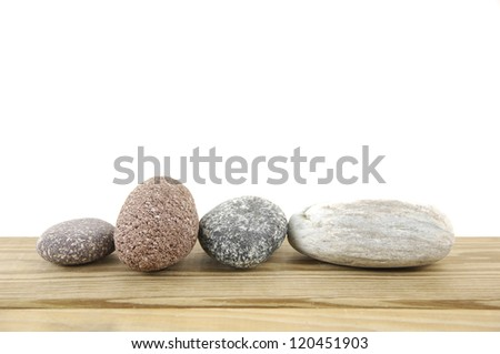 Set of close-up of colored stones on a wood board - stock photo