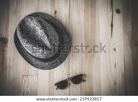 Set of clothes and various accessories for men on old wooden table - stock photo