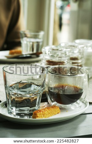 set of coffee,a freshly brewed of hot black coffee americano,drinking water and biscute with natural lighting   - stock photo