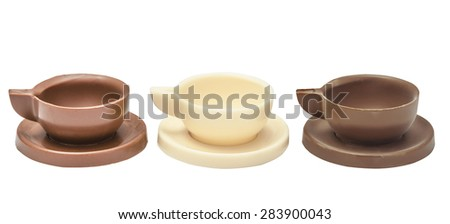 Set of coffee cup, mug and the saucer made of milk, black and white chocolate. Isolated, on a white background - stock photo