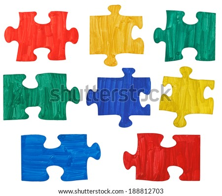 set of colored painted puzzle pieces isolated on white background - stock photo