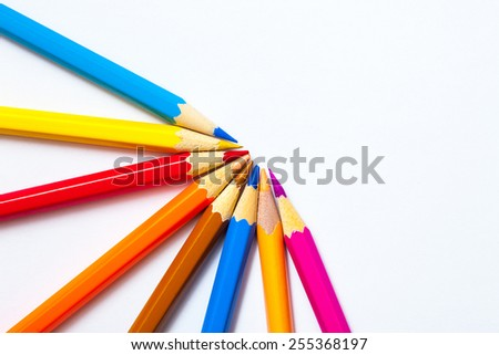 set of colored pencils and on white background with copy space - stock photo