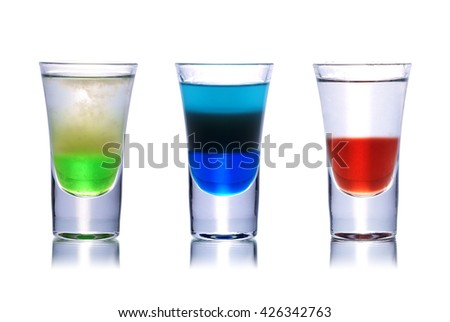 Set of colorful alcoholic cocktails in shot glasses isolated on white with reflection. Colletion of shooters - stock photo