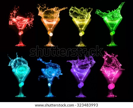 Set of colorful Bright cocktails in glasses on black background - stock photo