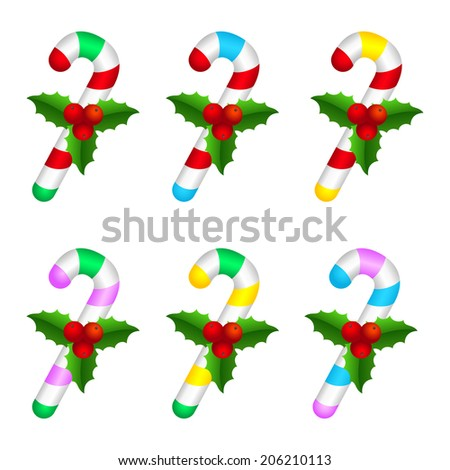 Set of colorful candy canes with holly berry. - stock photo