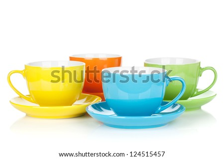 Set of colorful cups. Isolated on white background - stock photo