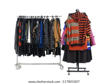 Set of Colorful different autumn/winter clothing on hanging - stock photo