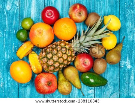 Set of colorful fruits on old wood background - stock photo