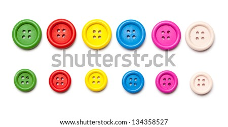 Set of colorful sewing buttons, shot from top with clothing buttons in red, blue, green, yellow. - stock photo