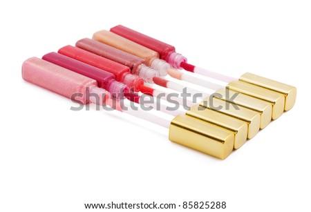 Set of coloured lip glosses isolated on white - stock photo
