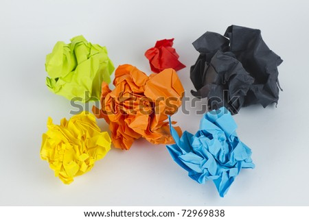 set of colourful crumpled paper balls on grey surface top view - stock photo