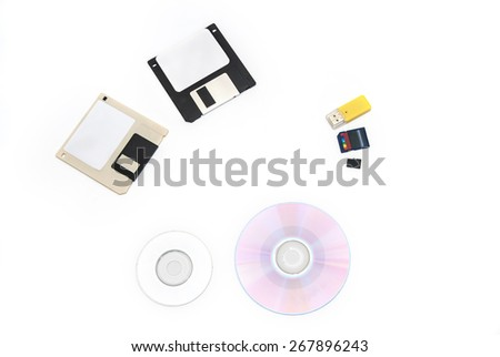 set of computer data storage media floppy disks, CD/DVD,  flash drive - stock photo