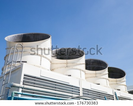 set of cooling tower on clear sky - stock photo