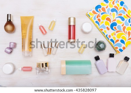 set of cosmetic bottles isolated on a background with space for text - stock photo