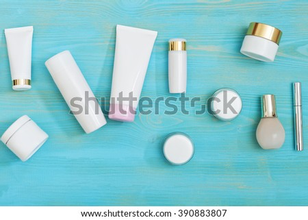 set of cosmetic bottles  isolated on a blue background with space for text - stock photo