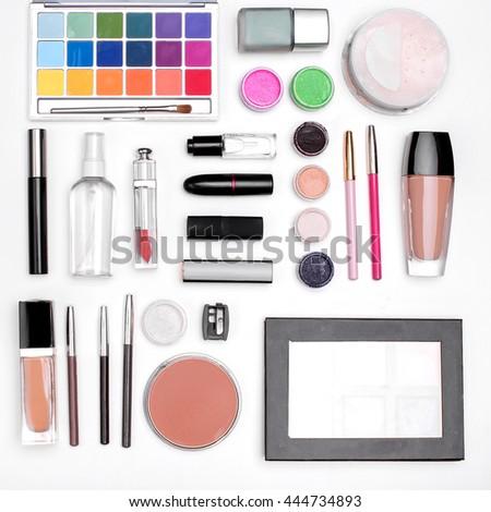 set of cosmetics: eye shadow, lipstick, mascara, powder, lip pencil, Foundation. top view  - stock photo