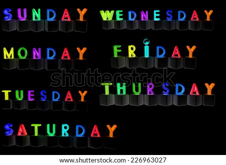 Set of 3d cubes with letters - days of the week on a black background - stock photo