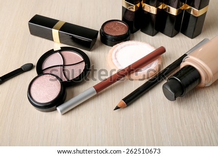Set of decorative cosmetics on wooden table background - stock photo