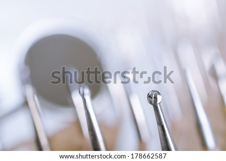 Set of dental drills with mirror in the background. Close up - stock photo