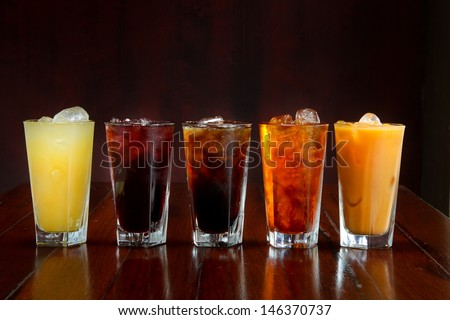 Set of different Asian soft drink on wooden table - stock photo