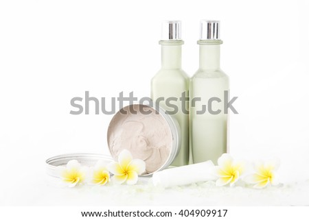 Set of different cosmetic product with frangipani flowers - stock photo