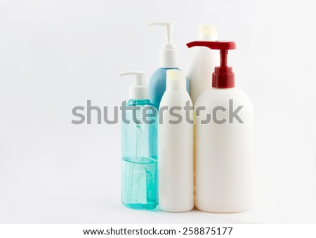 Set of different cosmetic products for personal care: shampoo, conditioner and shower gel on white background - stock photo