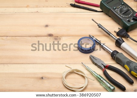 Set of different tools for repair and construction: hammer,pliers,screwdriver,screws,drill set,tape measure,wrench,hand tool - stock photo