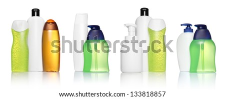 Set of different white, orange, green, blue bottles for beauty, hygiene and health on a white background with reflection, they shampoo, conditioner and hair products, each of them shot on separately. - stock photo