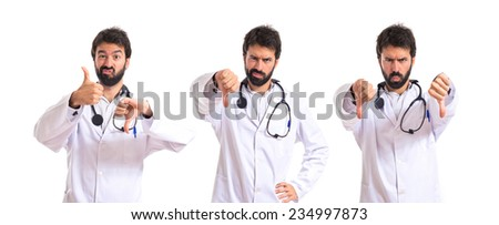 Set of Doctor doing a bad signal over white background - stock photo