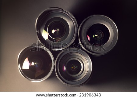 Set of DSLR lenses, different sizes and reflections. - stock photo