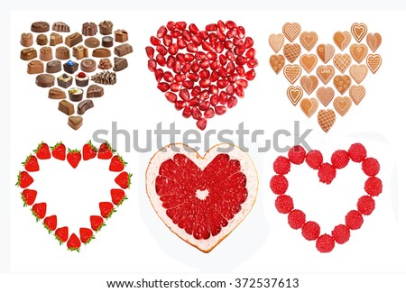 Set of edible hearts cookies, chocolate, pomegranate, strawberry, raspberry, grapefruit. St. Valentines or love concept. Isolated on the white - stock photo