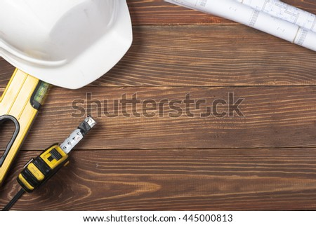 Set of electrical tool on wooden background. Accessories for engineering work, energy concept. Top view - stock photo