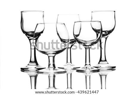 Set of empty glasses on white - stock photo