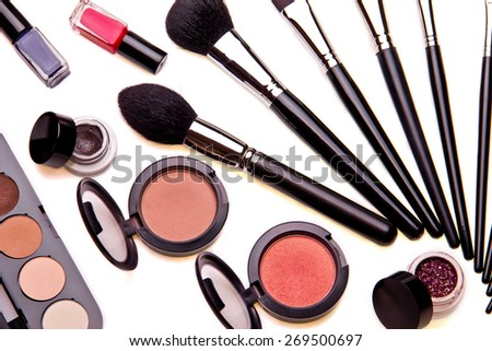 Set of essential professional make-up brushes and eye shadows are isolated with shadows on white background. Overhead view. - stock photo