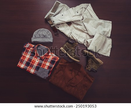 Set of fashionable male clothing in casual style on wooden background, top view - stock photo