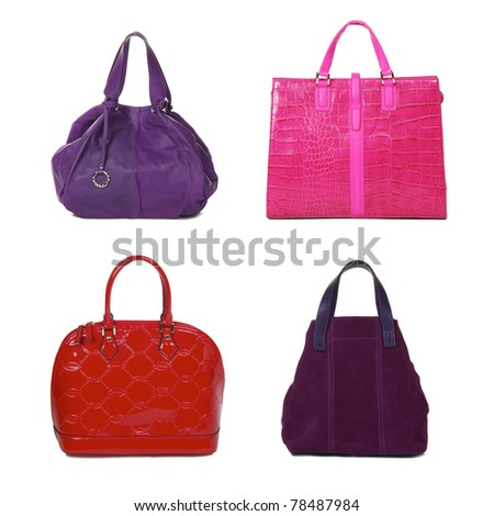 set of female bags of different color isolated on white - stock photo