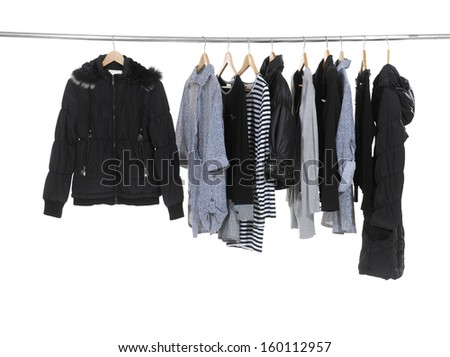 Set of female clothes hanging on clothes rack  - stock photo