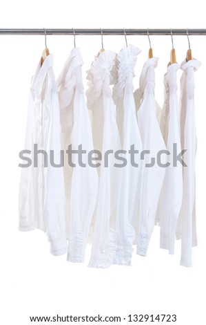 Set of female jacket on hangers at the show - stock photo