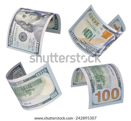 Set of flying one hundred dollars bills. Isolated on white - stock photo